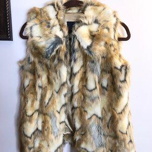 Designer's faux fur vest,size XXS